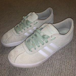 Adidas flat bottom light green sneakers